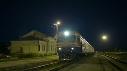 Train coming to rural station Stock Video Footage