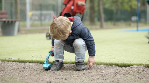 Boy playing with toy outdoor Stock Video Footage