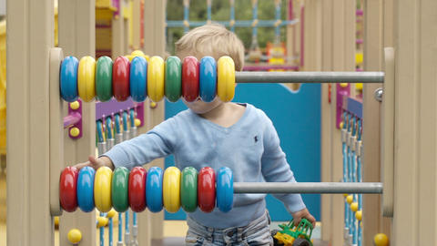 Little boy playing with an abacus Footage
