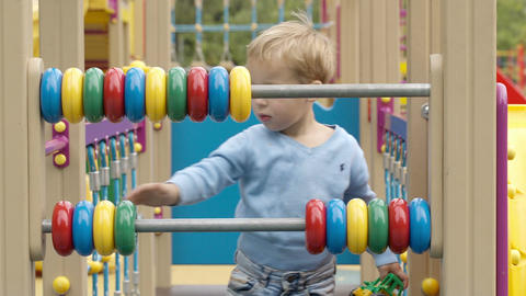 Little boy playing with an abacus Stock Video Footage