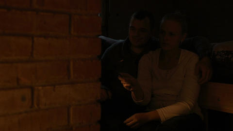 Couple Warming Near Stove stock footage