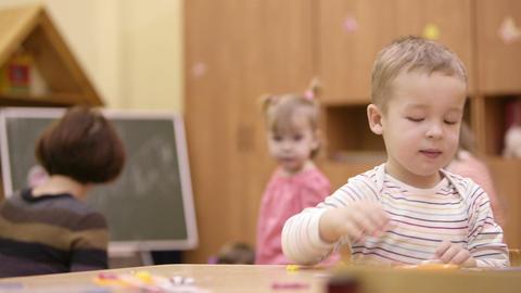 Little boy in the nursery Stock Video Footage