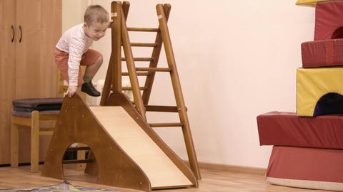 Young boy playing on an indoor playground Stock Video Footage