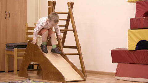 Young boy playing on an indoor playground Footage