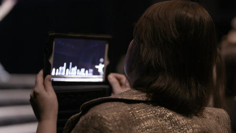 Woman shooting with touchpad Stock Video Footage