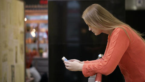 Young woman using smartphone Stock Video Footage