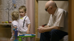 Grandfather and childred playing Stock Video Footage