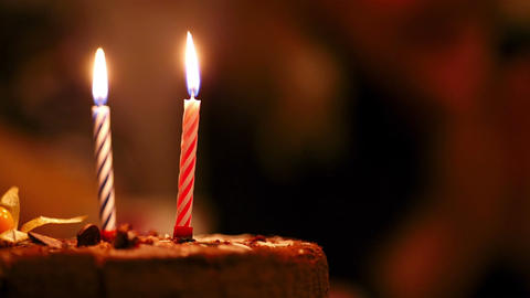 Candles on birthday cake Stock Video Footage