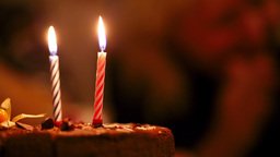 Candles on birthday cake Live Action