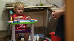 Little boy playing toy piano Stock Video Footage