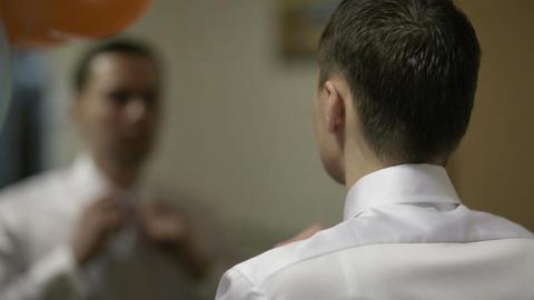Groom fixing his tie Footage