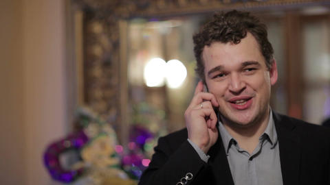 Happy smiling man chatting on a mobile Stock Video Footage
