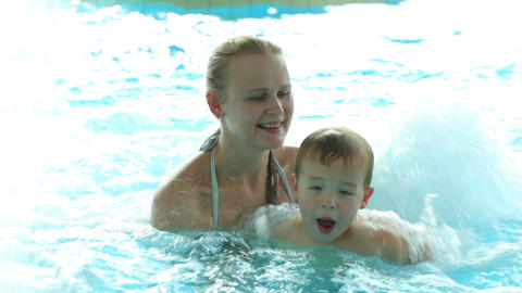 Mother and her son in the swimming pool Stock Video Footage