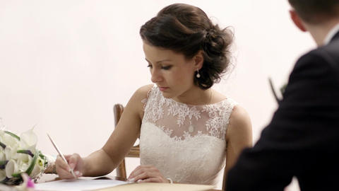 Bride signing marriage license Footage