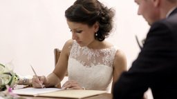 Bride signing marriage license Stock Video Footage