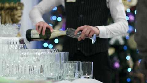 Waiter pouring glasses of champagne Footage