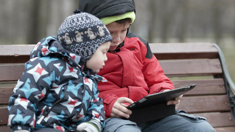 Brothers with tablet computer Stock Video Footage