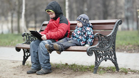 Two brothers with tablet computer Stock Video Footage