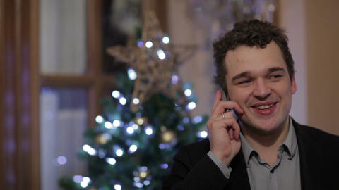 Young man smiling while talking on the phone Stock Video Footage