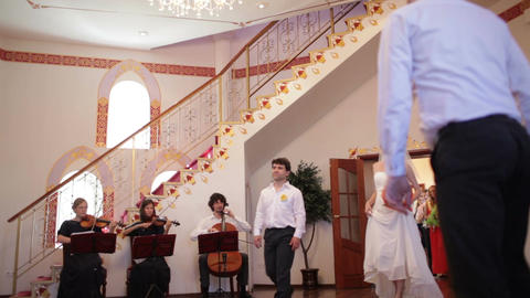 Band playing as the bride enters the room Stock Video Footage