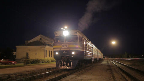 Traing leaving small rural station Stock Video Footage