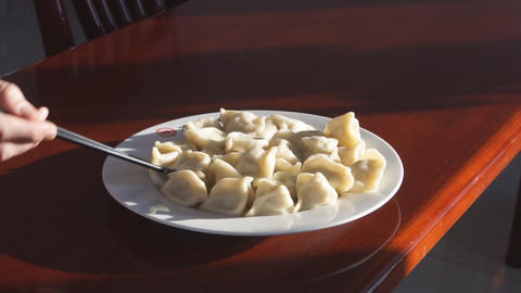 Eating Chinese Dumpling Jiaozi 02 stock footage