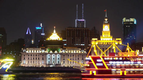 time lapse,Brightly lit ships cruising Shanghai Bund at night,old building Animation