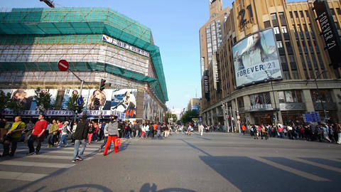 Chinese people crossing busy street downtown Shanghai... Stock Video Footage
