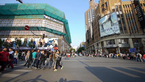Chinese people crossing busy street downtown Shanghai nanjing-road,urban traffic Animation