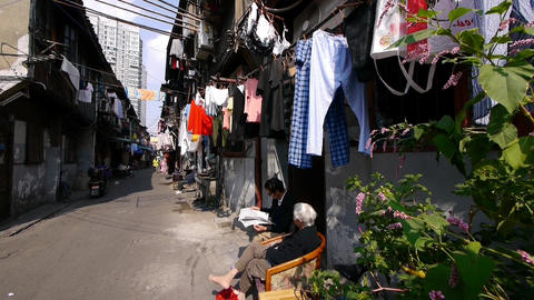 Typical Chinese old town street,china old woman leisurely... Stock Video Footage