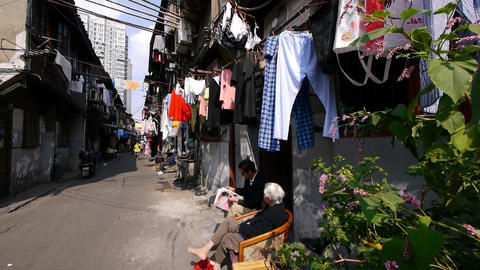 Typical Chinese old town street,china old woman leisurely sitting in a chair Animation