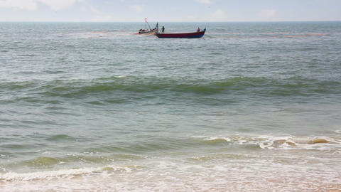 fisherman boats in sea - Kerala India Stock Video Footage