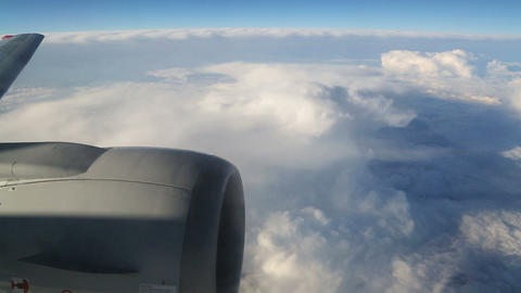 view from airplane on clouds wing and engine Stock Video Footage