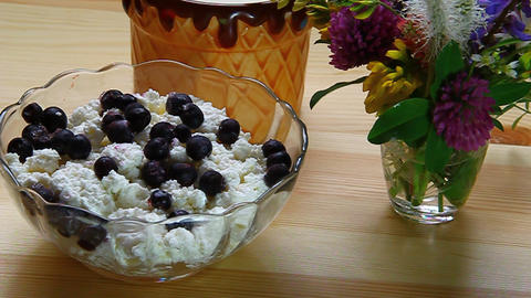 Blueberries stirred with a spoon with cottage chee Stock Video Footage