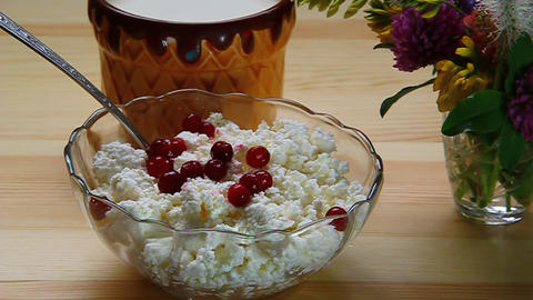 Berry cranberries mixed with a spoon with cottage Stock Video Footage