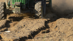 Tractor plowing field close up Footage