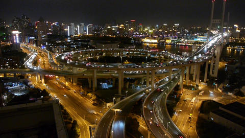 slow moving cars on overpass interchange,Brightly lit... Stock Video Footage