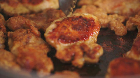 Pan Fried Chicken Flipping Stock Video Footage