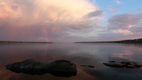 sunset on the river - rainbow is in clouds Stock Video Footage