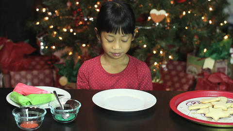 Girl Decorating Bell Shaped Christmas Cookie Stock Video Footage