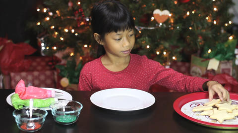 Girl Decorating Star Shaped Christmas Cookie Stock Video Footage