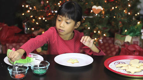 Girl Decorating Star Shaped Christmas Cookie Footage