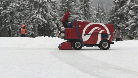 Zamboni Ice Cleaner On Outdoor Skating Rink Footage