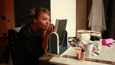 Girl Puts Makeup Stock Video Footage