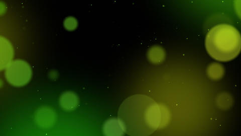 Defocused particles background. Green and yellow Animation