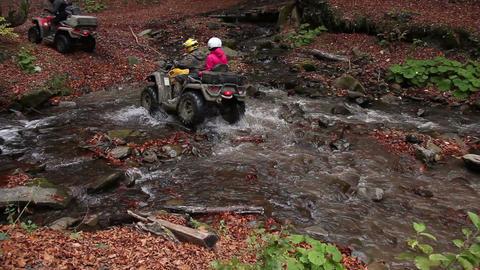 quadbikes crossing river Stock Video Footage