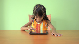Young Asian Girl Using a Tablet PC Stock Video Footage
