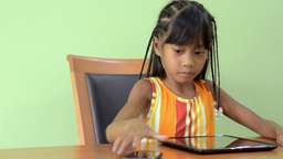 Young Asian Girl Answers Her Cell Phone While Play Stock Video Footage