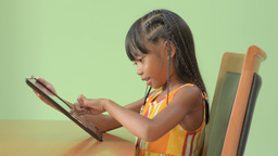 Young Asian Girl Enjoying Playing on an iPad Stock Video Footage