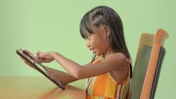 Young Asian Girl Enjoying Playing on an iPad Stock Video Footage